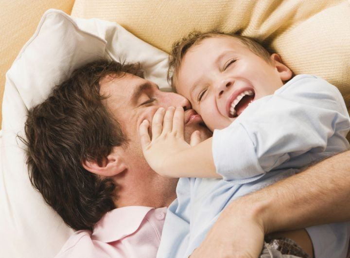 Dad_and_son_cuddling_Getty_93226515.jpg